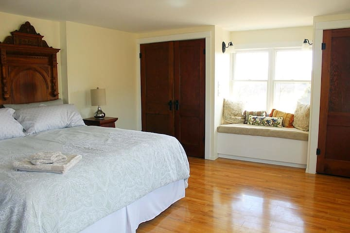 Master bedroom. King size bed, 1870s walnut headboard, cozy nook between his and hers closets.