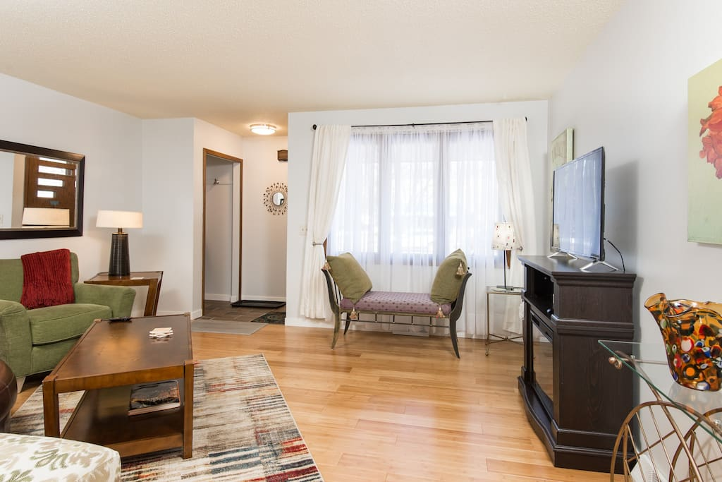 Living room is nicely decorated and comfortable.  Kick back and relax after a long day of sight seeing or business meetings.
