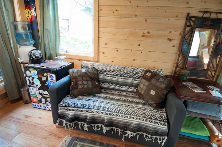 small couch and fridge