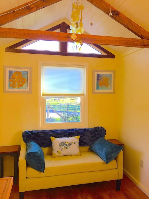 cozy settee w/ view to pasture & horses