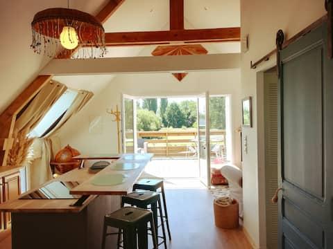 Appartement loft avec terrasse sur jardin