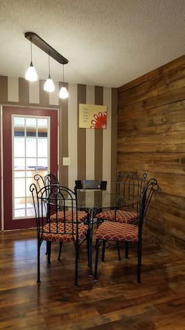The home has an open floor plan. The french doors open from the kitchen/dining room on to the back screen porch.