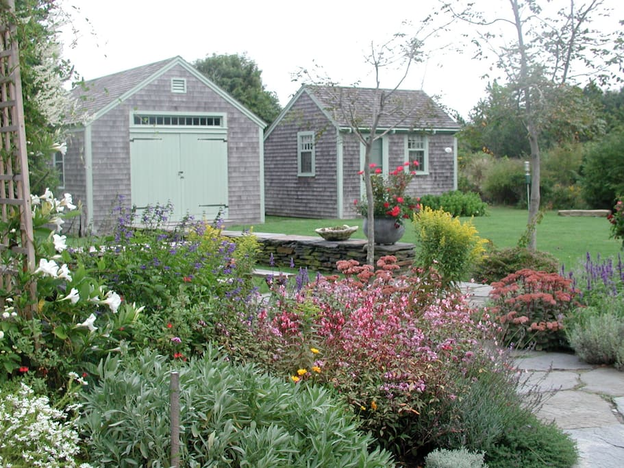 Gardens looking to Barn and Fish House