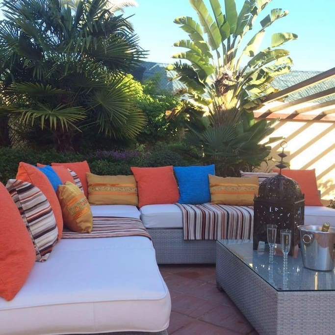 Large L shaped sofa situated  via large patio doors. A great place to relax and can be either in shade with the use of a large sun shade umbrella or in full sunshine.