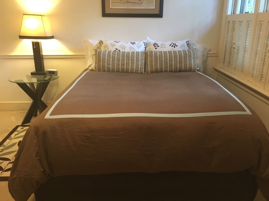 Spacious queen bed. Room is very bright with great sunlight. Features a large wall flat screen TV.