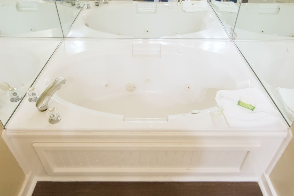 Master In-Suite Jacuzzi Tub with three walled Mirrors