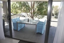 Open up large sliding doors to the deck to expand your entertaining area