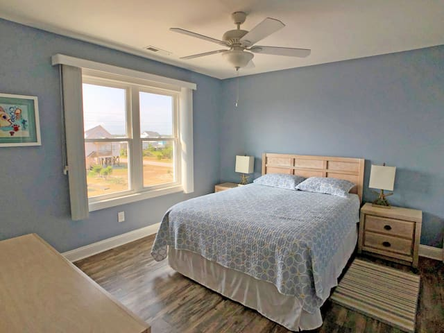 Upstairs queen bedroom, with private access to full bathroom.
