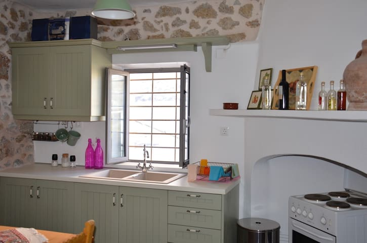Fully equipped kitchen for cooking.