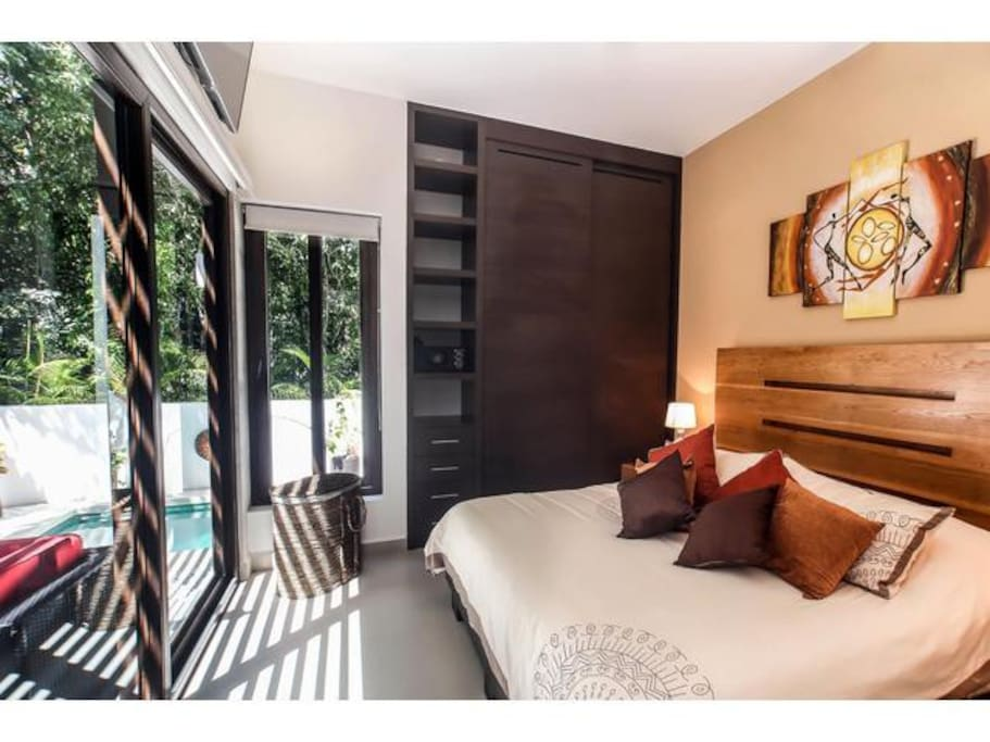 Master bedroom with king size bed facing the private patio