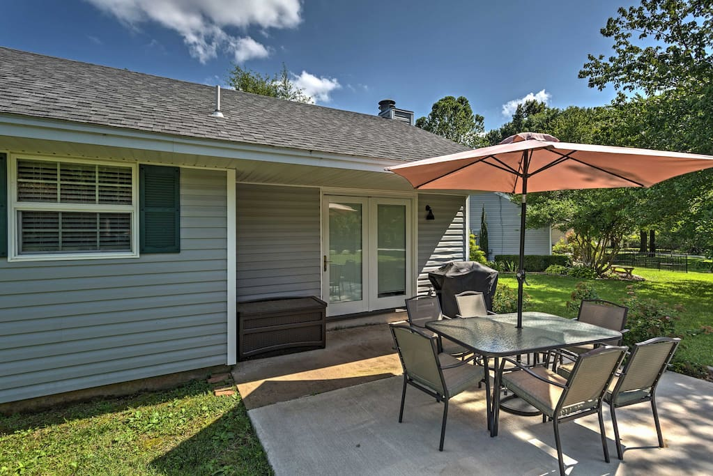 Enjoy lounging in the sun when you stay at this vacation rental cottage, complete with a charming backyard patio area.