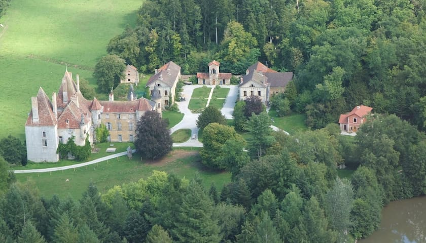 The estate: the Medieval castle, the symmetrical court yard . The Manor house on the  right side is  the Bed and Breakfast.  All the way on the right is the luxury holiday home.   Woodlands, a small lake, fields and a wonderful garden to enjoy .