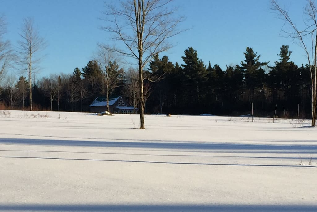 Winter view of the house from the field in front