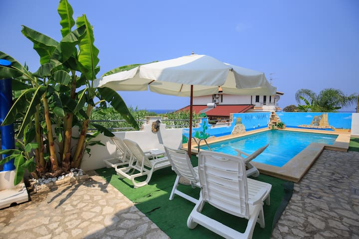 FAMILY Apartment directly on the beach with Pool