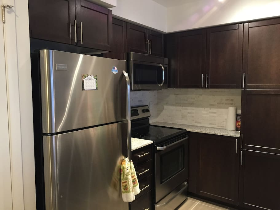 Brand new kitchen, ample of cabinet space and fridge space for groceries if you're planning on staying long term!