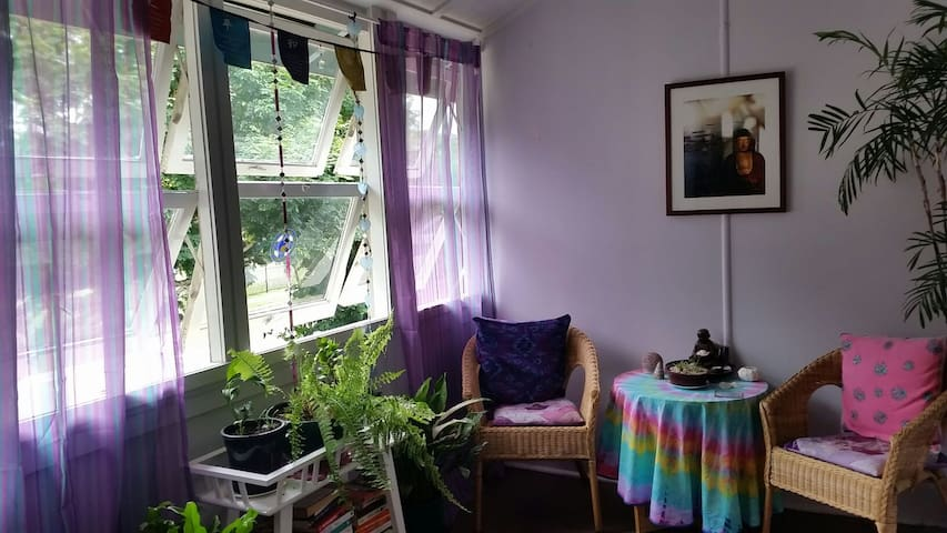 A beautiful sunroom for reading,  yoga or to entertain a visitor