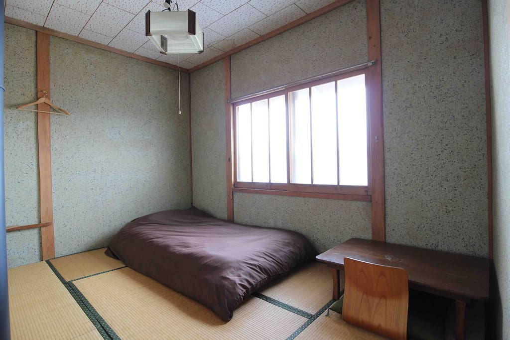 Traditional tatami room with alps vies. Futon style using thick mattress