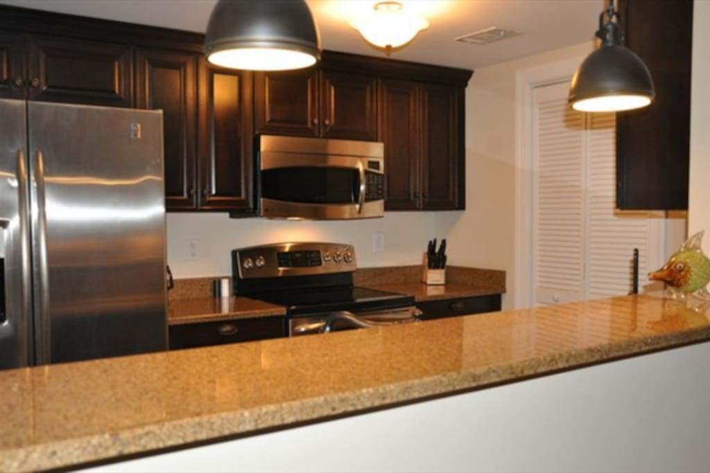 Fully equipped kitchen with granite counter tops,  stainless appliances