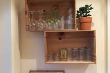 Drink anyone ? Glasses stored in wine crates .