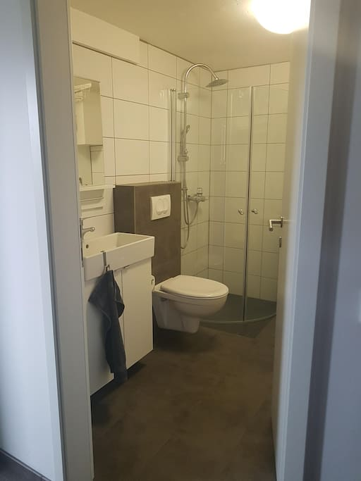 Bathroom with shower & washing machine...