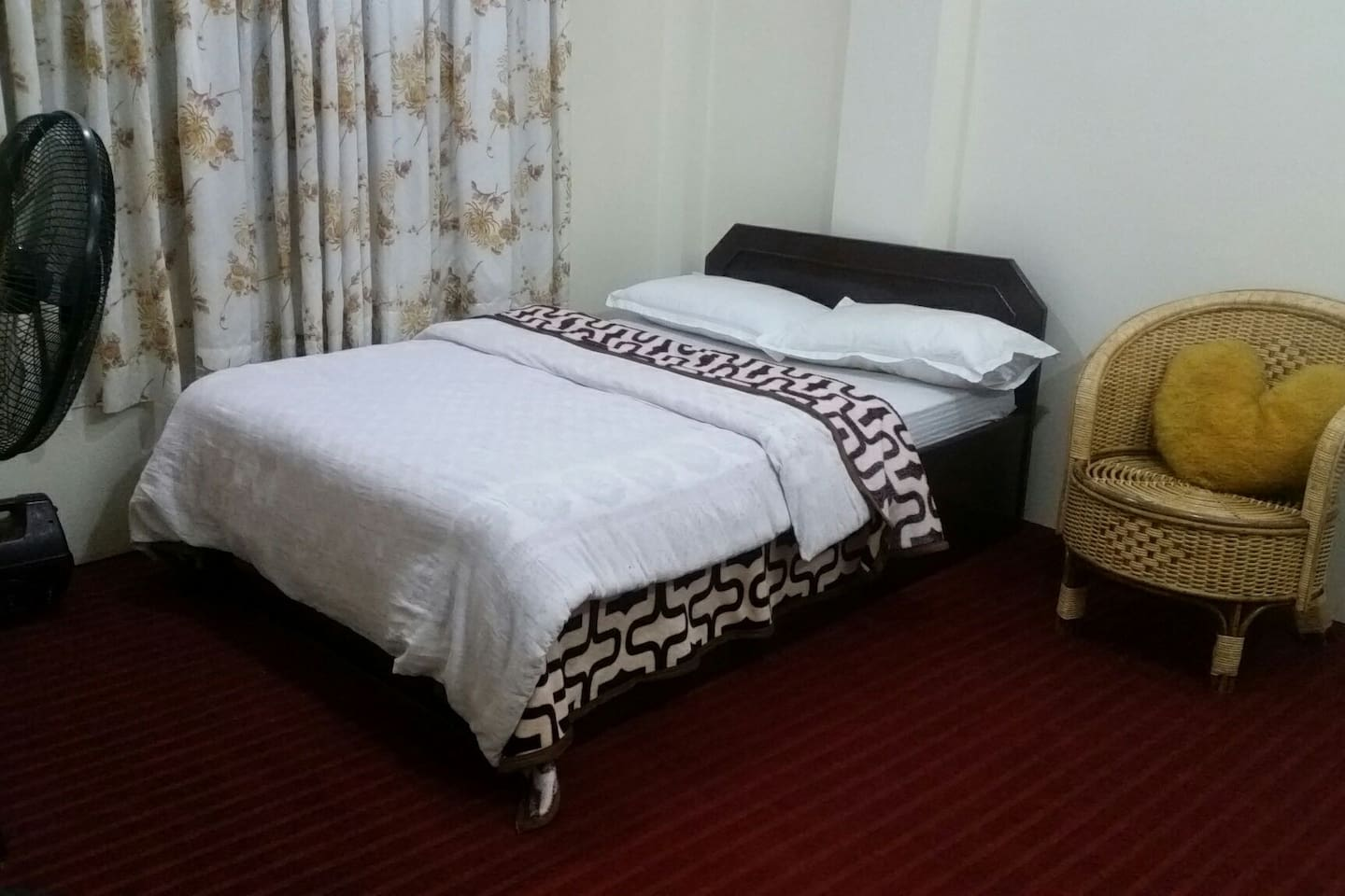 Spacious room with clean comfortable double bed