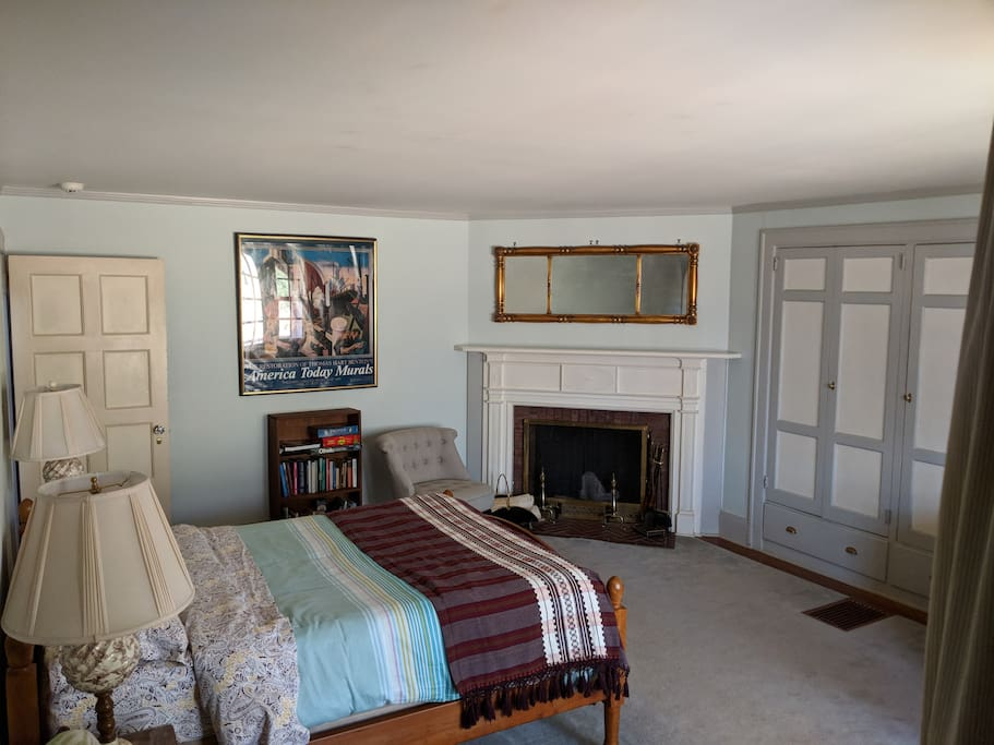 Decor includes beautiful antique mirror over the fireplace and built-in cabinets.