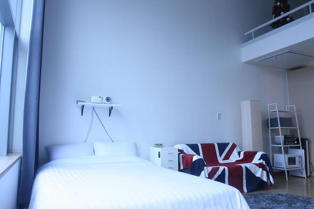 1st Floor: Queen-size Bed and Projector