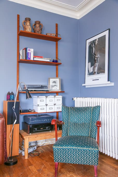 Cozy living room corner with a vinyl record player.