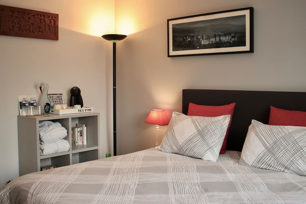 Suite with complimentary set-up of Dolce Gusto coffee and tea, mineral water, bathrobes and books