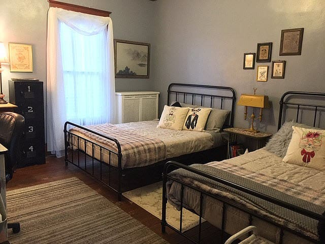 """This listing is for the entire """"flat"""" (2 bedrooms which sleeps 7 total). The Rococo Room #2 has 2 full sized beds  which sleeps 2 each (4 total).  A large couch in the L.R. and a toddler bed provides additional sleeping space."""