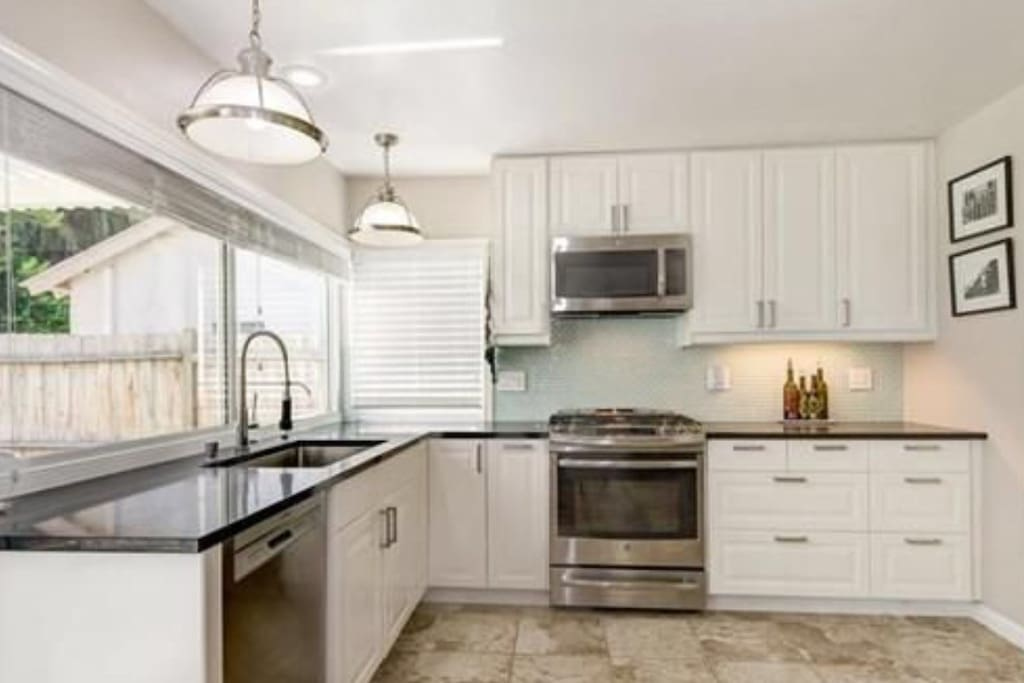Fully upgraded kitchen with stainless steel appliances.
