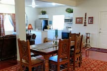 dining area; seats 6 comfortably.  hand carved wood table!