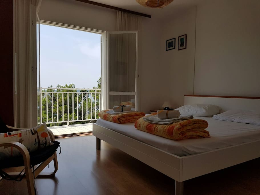 Second bedroom for two, with a balcony entrance overlooking Adriatic sea and Pakleni islands