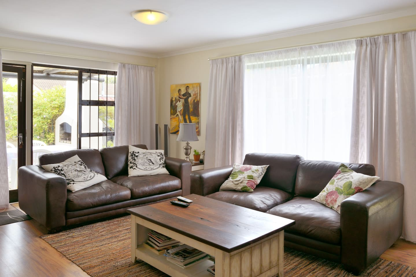 Lounge with comfy sofas and acess to the patio