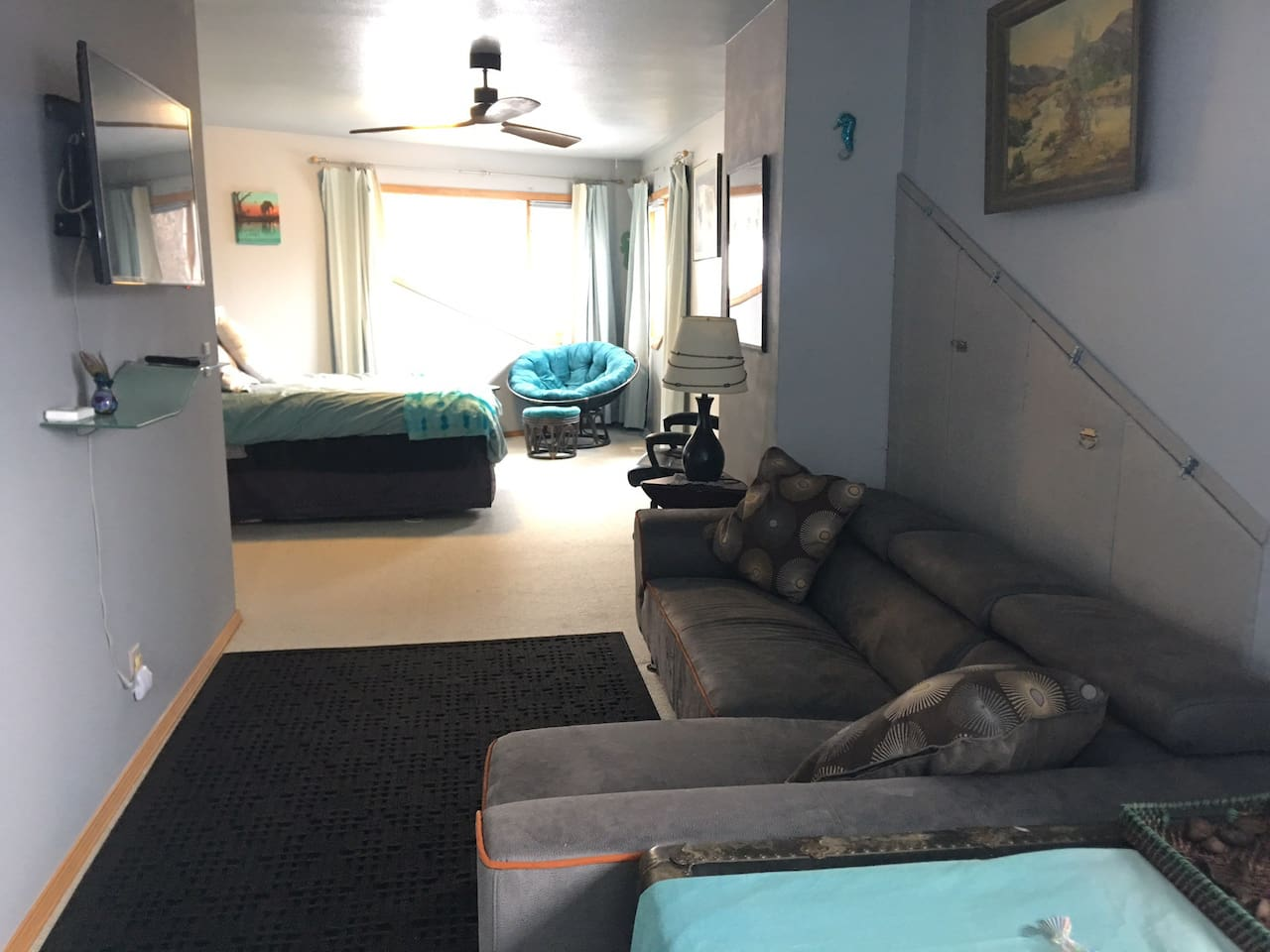 View of the queen bed, leather couch, tv etc