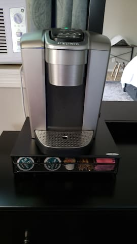 Coffee maker with creamer, sugar and sweet and low packets