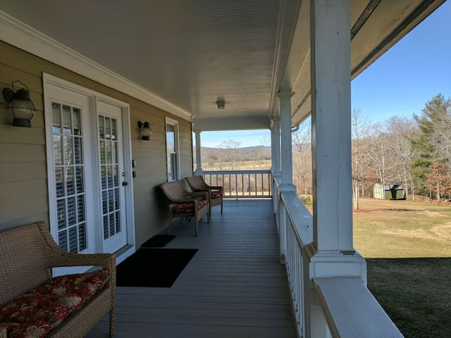 Relax on your private porch overlooking property. Great place for morning coffee and sunrise or glass of wine and a brilliant sunset.