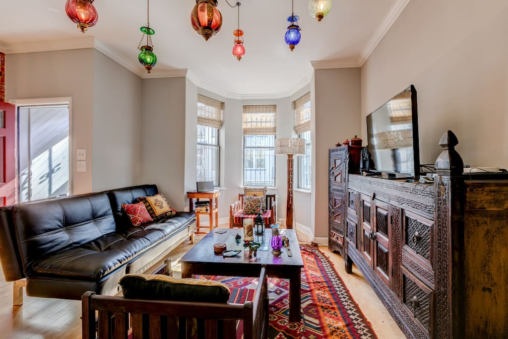 Sun Drenched Living Room and Entertainment Center W/ Smart TV