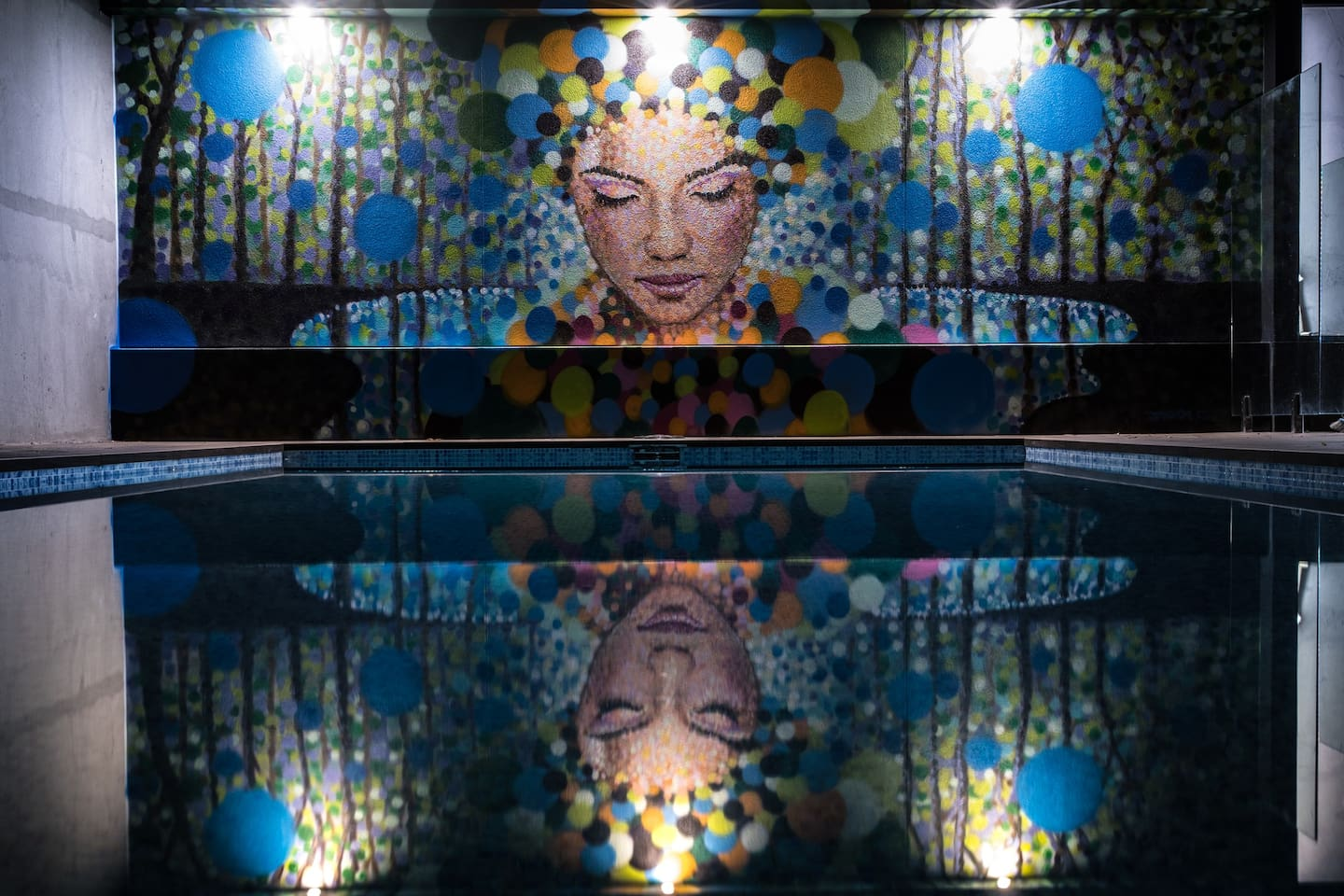 The swimming pool at night with 'Adelaide' painted by the world famous Jimmy C.