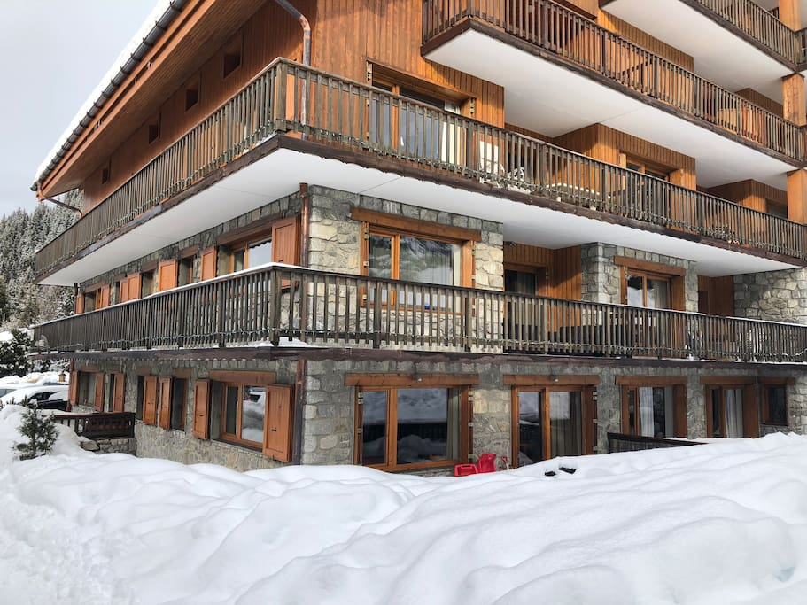 The ground floor 5 window corner apartment facing snow field on one side, the valley on the other. Sledge is provided for kids to enjoy