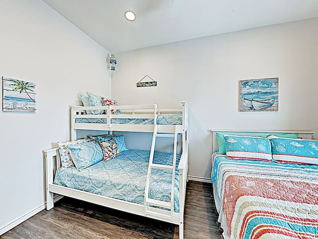 Sleep soundly in the guest bedroom, outfitted with a queen bed and a twin-over-full bunk bed.