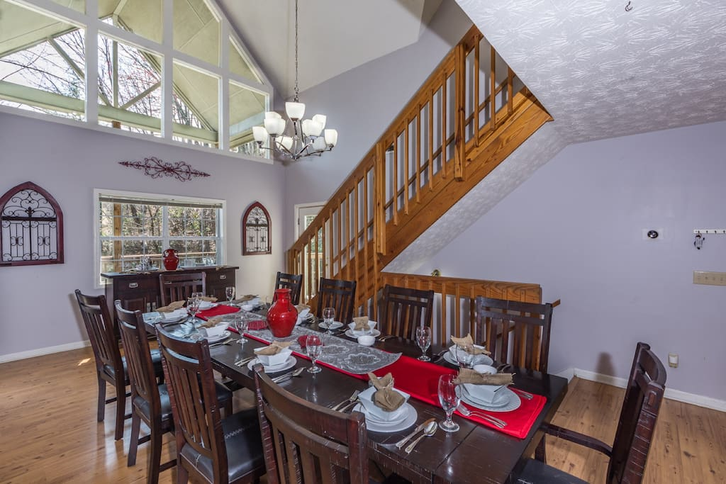 Large spacious dining table seats 12 and is open to kitchen and living room
