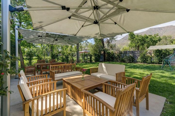 Beat the heat and dine outside under two industrial size umbrellas - seating for 8 (couche setup and separate dining setup)
