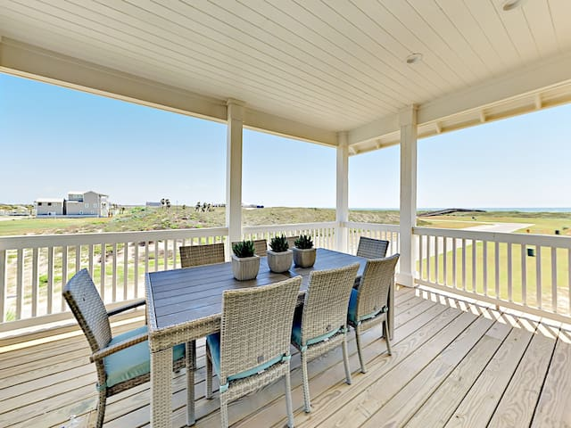 Upper deck overlooking golf course and bay -- dine alfresco at the 8-person patio table.