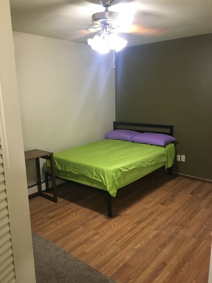 Master bedroom with full/double bed and ceiling fan.