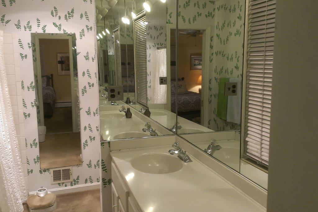 Private full master en suite bathroom with shower and dual sinks.