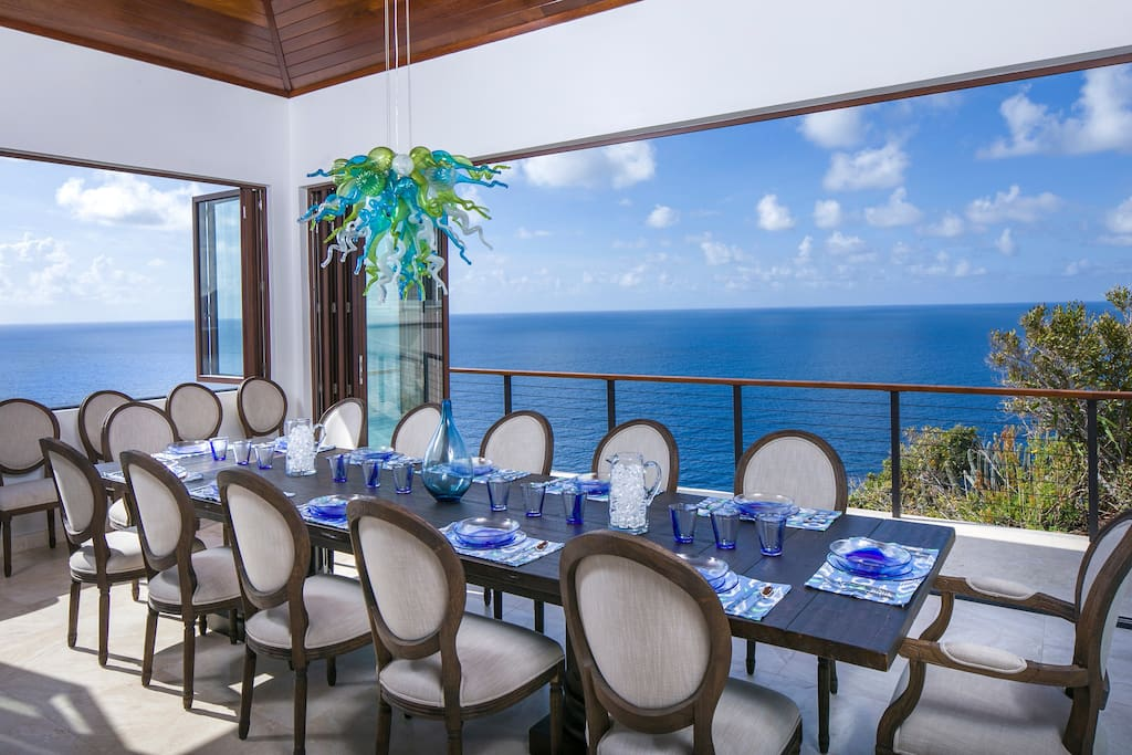 Dining for 14, Nana Wall open for ocean breezes, or closed to enjoy the icy air conditioning.