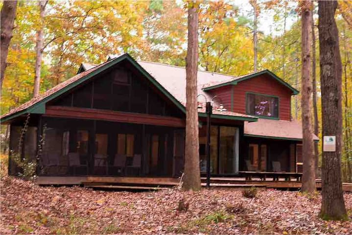 A genuine cedar home  with large deck and 2 screened in porches.