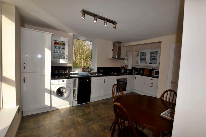Kitchen with gas hob and electric oven,  washing machine, fridge freezer and dishwasher