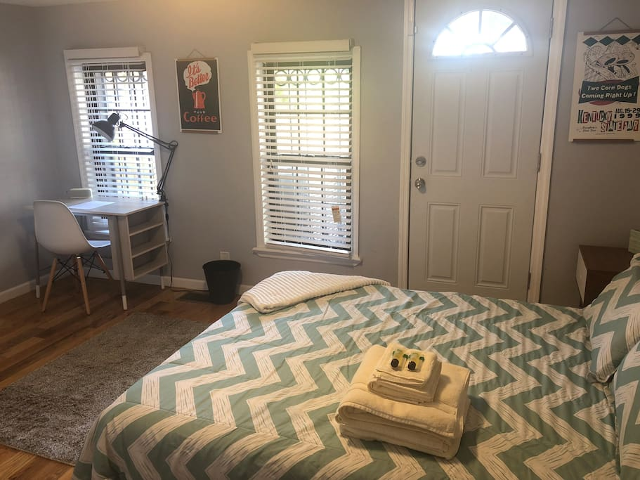 Spacious room has two large windows and a door for direct access to the backyard.